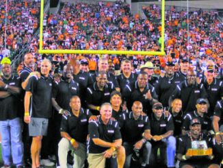 Former members of the Cincinnati Bengals 1988 Super Bowl team were recognized at the first home game this season. Quarterback Boomer Esiason and Coach Sam Wyche were unable to attend. Photo by Michael Mitchell