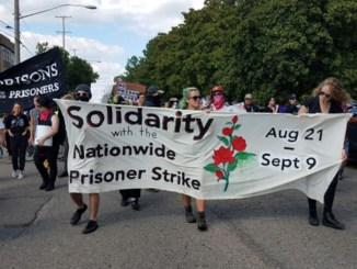 Marchers occupy Michigan Avenue in Lansing, Mich., on Aug. 23 in solidarity with the National Prison Strike.