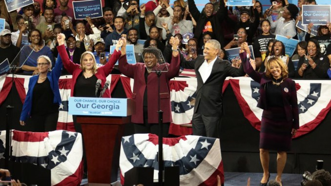 (Left to right) Carolyn Bourdeaux, Sarah Riggs Amico, Stacey Abrams, former U.S. President Barack Obama, and Lucy McBath celebrate on stage at a campaign rally at Morehouse College's Forbes Arena on Friday, November 2, 2018. Photo by: Itoro N. Umontuen / The Atlanta Voice