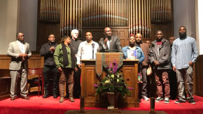 "During prayer vigil, noted civil rights attorney Benjamin Crump Jr. (at podium) with area leaders and family members of 21-year-old Emantic Fitzgerald ""E.J."" Bradford Jr. who was killed Thanksgiving night by a Hoover police officer inside the Riverchase Galleria. (Erica Wright Photo, For The Birmingham Times)"