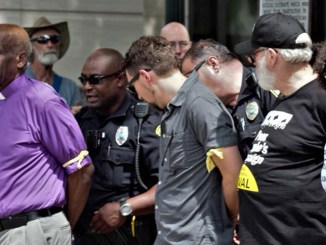 People being arrested are Pastor Chuck Rhodes and Aurie Margo Williams