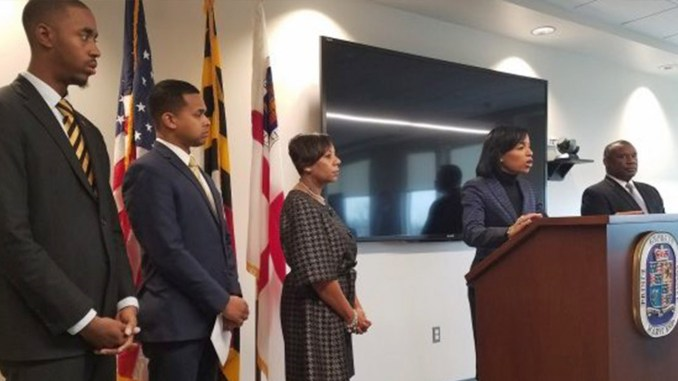 Prince George's County Executive Angela Alsobrooks introduces longtime education expert and advocate Alvin Thornton (right) as the new chair of the county's school board. (William J. Ford/The Washington Informer)