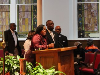 "Jefferson County Commissioner Sheila Tyson (at podium) speaks during prayer vigil for 21-year-old Emantic Fitzgerald ""E.J."" Bradford Jr., who was shot and killed by Hoover police. (Ameera Steward Photo, The Birmingham Times)"
