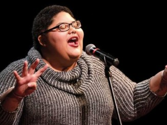 """Tanesha Nicole reads a poem at a """"Button Poetry Live"""" at Park Square Theatre in St. Paul clinching top honors for the night. (Photo by: Jeff Wheeler)"""