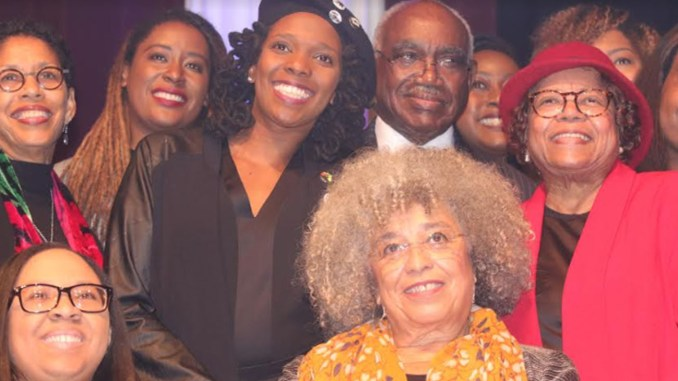 Dr. Angela Davis, (seated right) surrounded by members of The Birmingham Committee for Truth and Reconciliation (BCTR), who organized her visit to Birmingham. (Stephonia Taylor McLinn Photo, For The Birmingham Times)