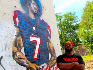 ArtistFabian Williams in front of his mural 'Kaeplanta'. (Photo by: A.R. Shaw)