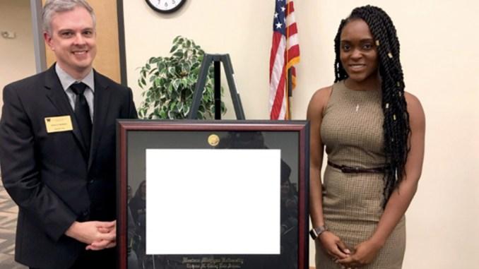 Ayana Clark is shown with Daniel W. Matthews, associate dean of WMU-Cooley Tampa Bay campus.