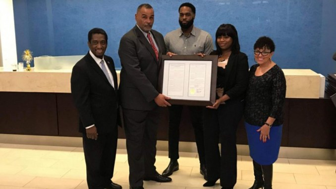 Receiving the honor from SCLBC Chair Rep. Jerry Govan (third from left) and members of the Charleston Legislative Delegation for Septima P. Clark were (at the center of the picture) her grandson, Nerie Clark, and great-grandchildren Kevin and Michelle Clark.