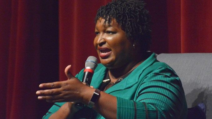 Stacey Abrams explains her position on Medicaid expansion at the Porter Sanford Arts and Community Center in Decatur Thursday, November 1, 2018. (Photo by: Itoro N. Umontuen)