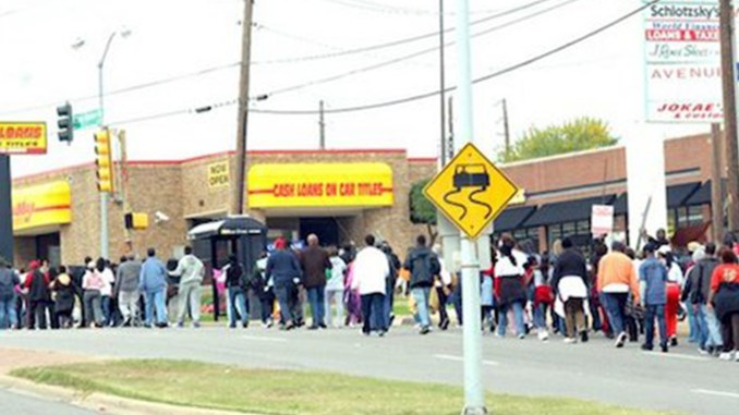 Protesters march in 2015 past one of 17 predatory lending businesses in South Dallas, Texas. (Courtesy of Paul Malbrough)