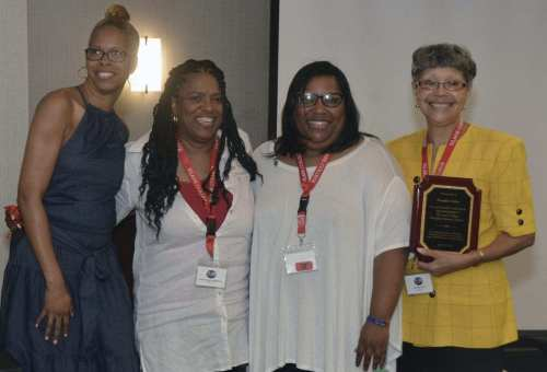 """Frankie Grice (right) had plenty of support as she received an award for """"your tireless hard work and dedication to The Lane College Memphis Alumni Chapter."""" Photo: Tyrone P. Easley)"""