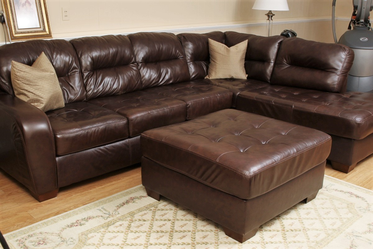chocolate brown leather sectional sofa with 2 storage ottomans table made in usa ashley furniture faux ottoman
