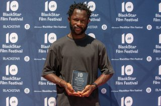 Arie Esiri accepts the award for Best Feature Narrative at the 10th annual BlackStar Film Festival