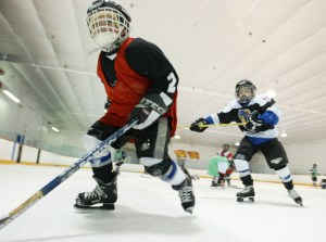TORONTO OUT Catrholic Elementary School board strike_21/5/03_TG_ Christopher Metcalf of Blessed Sacrement Elementary school races by for the puck during a game at Rinx recreation centre. Vic Casale, a parent of one of the children, organized the event. (Tobin Grimshaw/Toronto Star/Digital image)