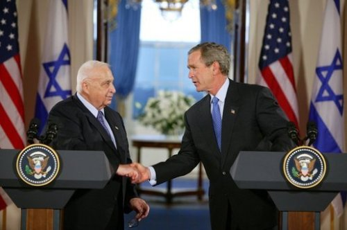 Ariel Sharon and George W Bush - War criminals meet and greet.