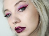 Blonde girl wearing purple shadow and red liner