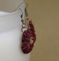 Red Poinsettia earrings made from black walnut shells in ...