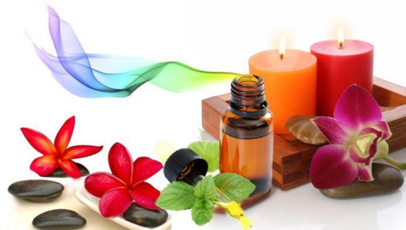 pipet dan botol minyak atsiri beserta lilin aromaterapi