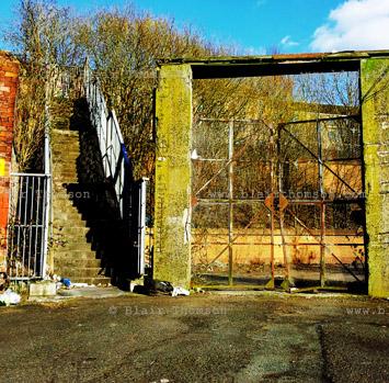 gateway closed, steps amidst modern ruins