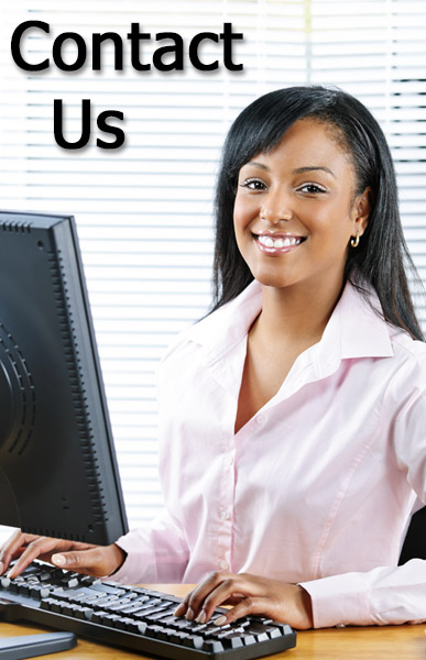 Woman at computer smiling at you