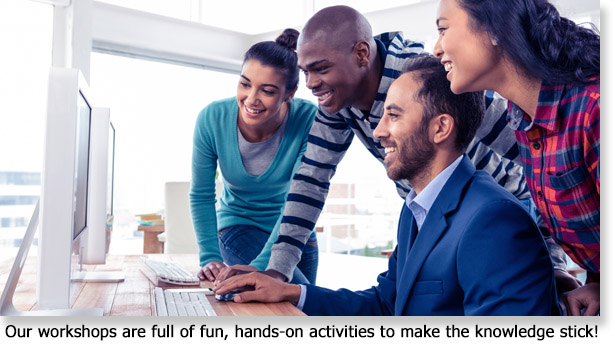 Four people around a computer screen using interactive learning