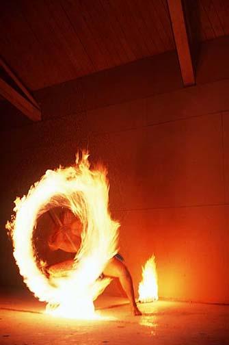 a polynesian fire staff spinner