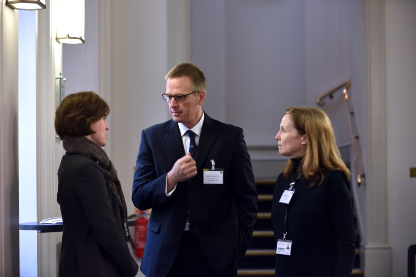 Professor Anthony Bull and Dr Emily Mayhew networking with delegates during one of the tea and coffee breaks.