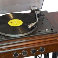 Vintage Singer sewing machine tables transformed into turntable consoles