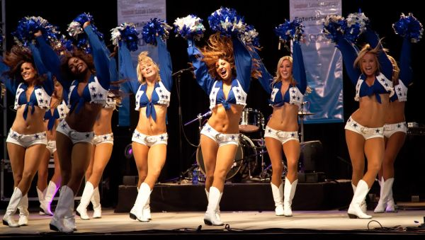 Dallas Cowboys Cheerleaders perform routines for the American Association of Airport Executives convention held at the Cowboys Stadium on May 17, 2010 at Dallas, Texas.