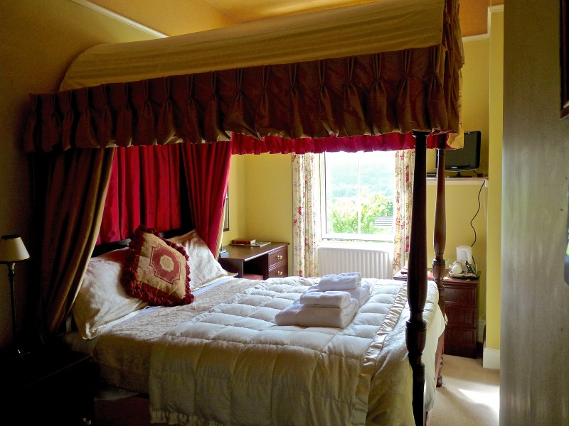 The Coniston is a standard 4-poster room with excellent views of Lake and fells. It has a shower en-suite.