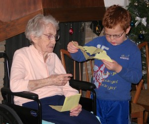 A great-grandma and her precious redheaded great-grandson.