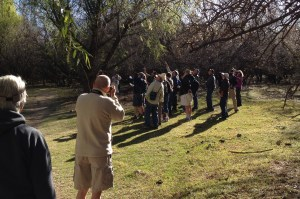 Pedro snags a photo of my mom watching my dad take a photo of birders--I'm the Ms. Frizzle-looking youngish one.