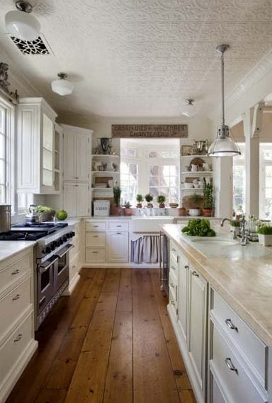 Such a pretty country kitchen with the heart of pine floor and white cabinets.