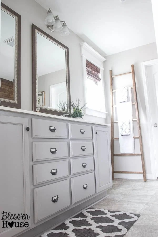 The Cheapest Resource for Bathroom Mirrors (and Bathroom Makeover Progress) | Bless'er House - Those big driftwood mirrors were only $19!