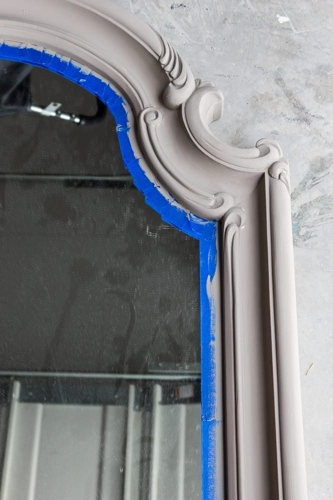 Distressed Charcoal Scroll Mirror Makeover | blesserhouse.com - How to distress non-wood materials without sanding using Vaseline. This is smart!