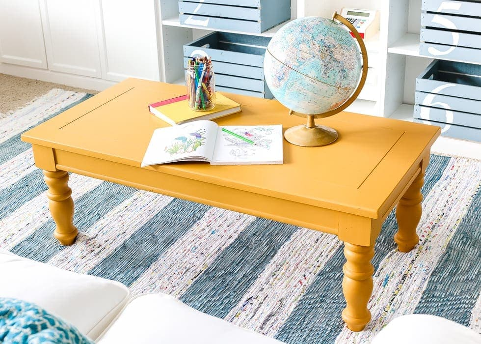 Mustard Playroom Coffee Table Makeover | blesserhouse.com - An old thrifted wooden coffee table gets a bright and cheerful makeover using Fusion Mineral Paint in Mustard for a fun addition to a playroom.