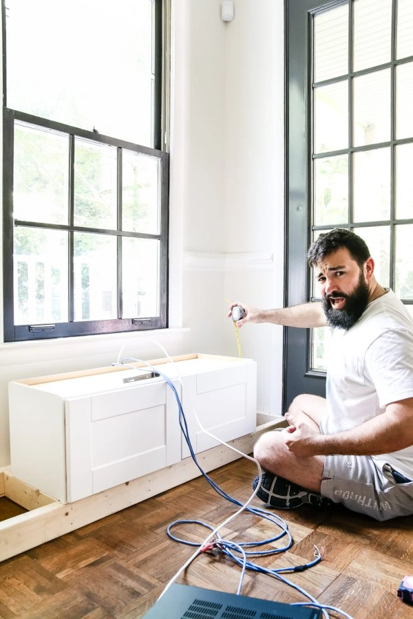 DIY Window Seat from a Kitchen Cabinet | blesserhouse.com - A simplified tutorial for how to build a DIY window seat using a prefabbed kitchen cabinet to house electronics and hide cords.