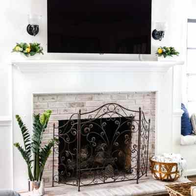 DIY Lime Washed Brick Fireplace