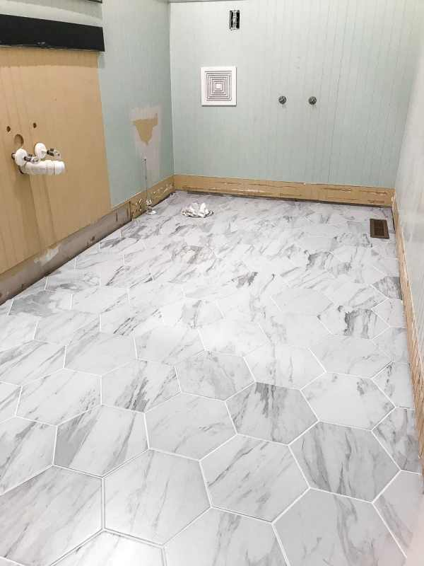 The Best Faux Marble Tile | blesserhouse.com - A dated powder room floor gets a modern classic refresh with faux marble tile & why hiring a contractor is sometimes cheaper than DIY.