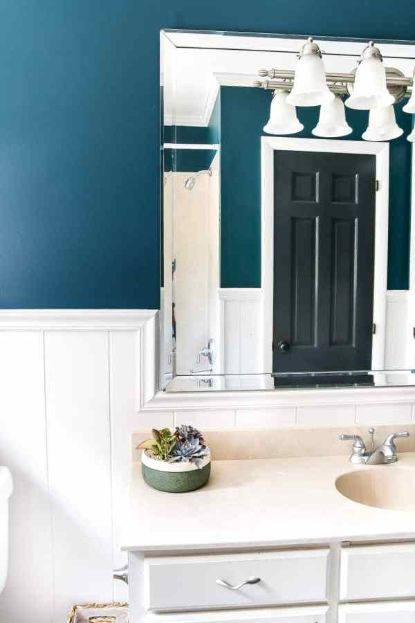 Teal Painted Bathroom Makeover | blesserhouse.com - A boring, dated beige bathroom gets a fresh teal painted makeover with Magnolia Home Paint in the color Weekend and Ben Moore Simply White and Wrought Iron.