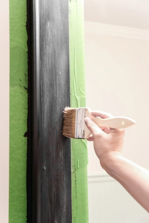 Dry Brushed Black Mirror Makeover | blesserhouse.com - A plain, white painted bathroom mirror gets a high-drama weathered makeover with black paint and dry brushing. (Tutorial)