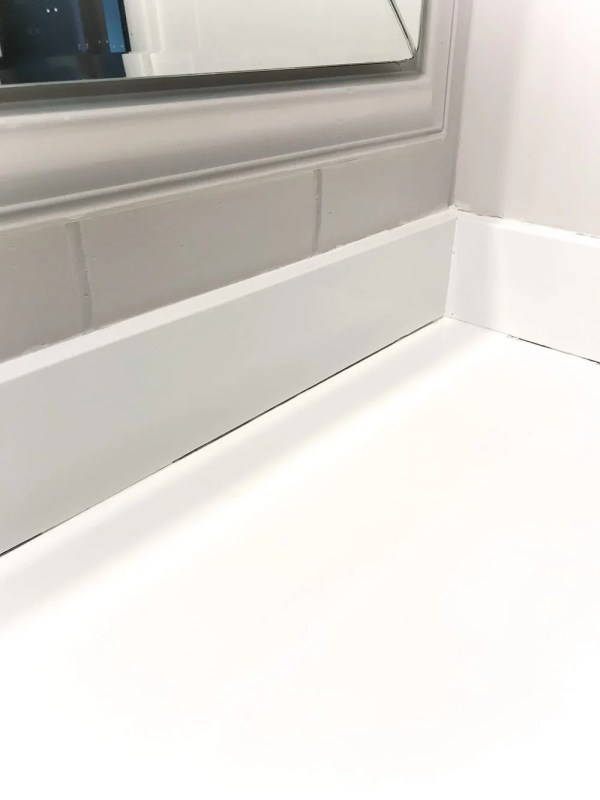 DIY Painted Bathroom Sink Countertop   blesserhouse.com - An 80s beige cultured marble sink and countertop get a bright white makeover using super durable paint meant specifically for sinks, tubs, and showers
