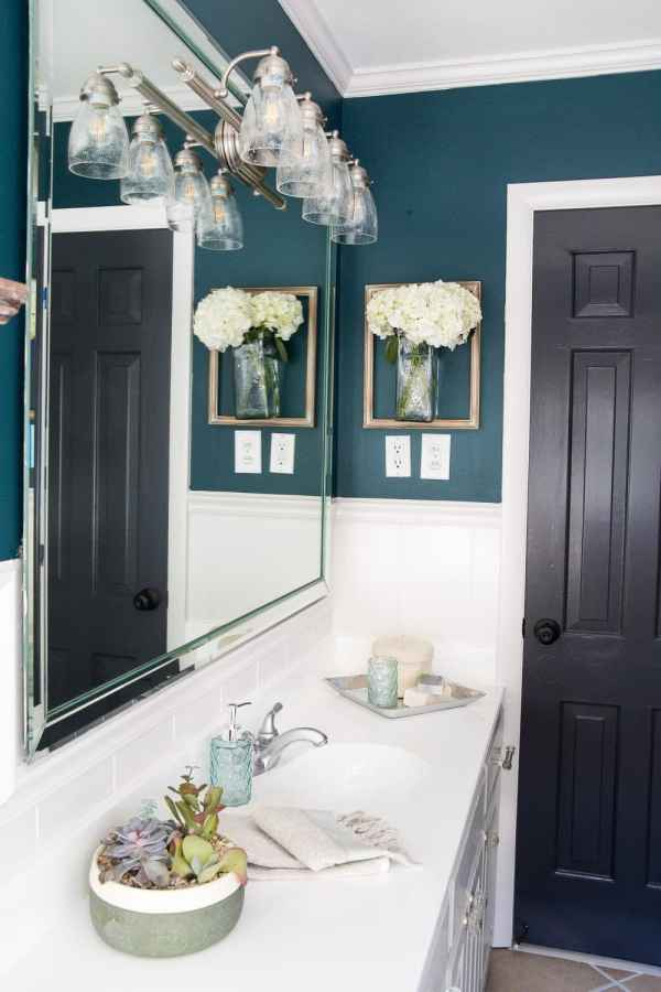 Kid's / Guest Bathroom Makeover on a Budget | blesserhouse.com - A shared kid's / guest bathroom gets a full makeover for less than $500 using just paint, DIY tutorials, and decorating tricks. #bathroom #homeimprovement