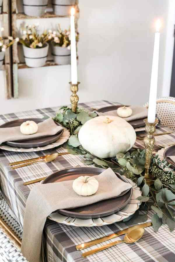 Neutral Low-Key Thanksgiving Tablescape | blesserhouse.com - A neutral low-key Thanksgiving tablescape that is simple and inexpensive to recreate using plaid fabric, white pumpkins, eucalyptus, and brass.