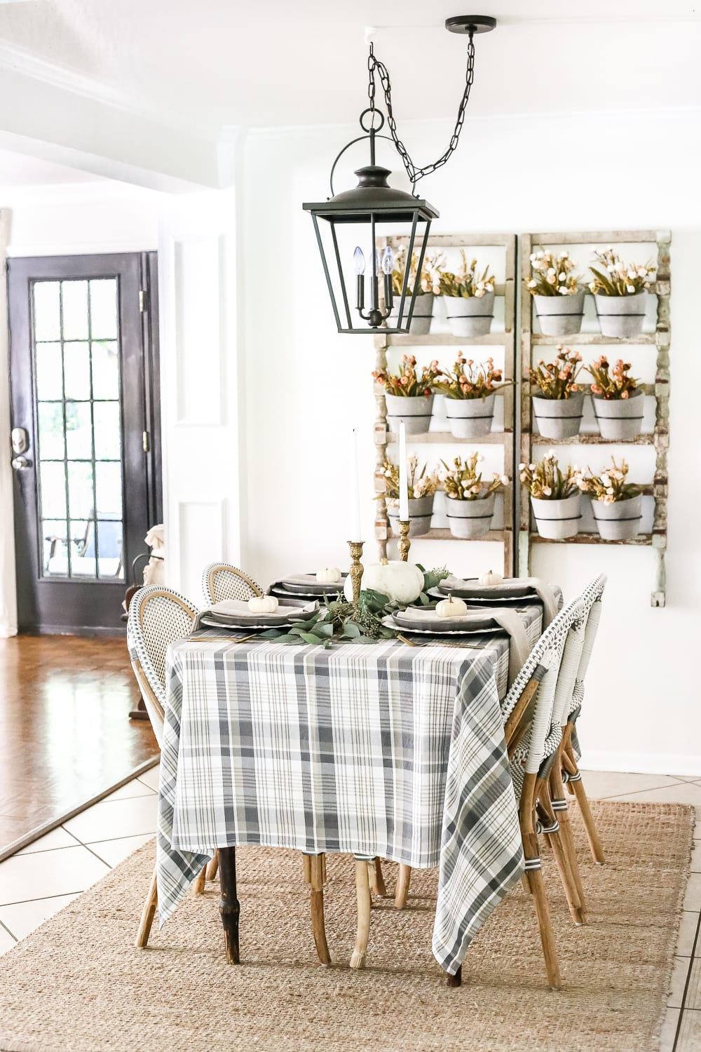 fall table with plaid tablecloth and wall planter