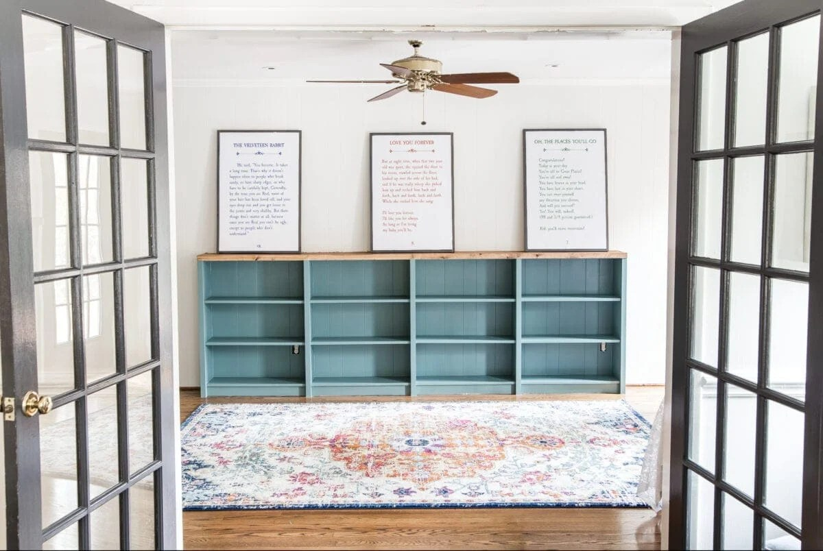 An easy to follow step-by-step tutorial showing how to build bookcase built-ins using IKEA Billy bookcases. #IKEAhack #homeimprovement #build #playroom Sherwin Williams Tree Swallow, Ben Moore Wrought Iron, and Ben Moore Swiss Coffee