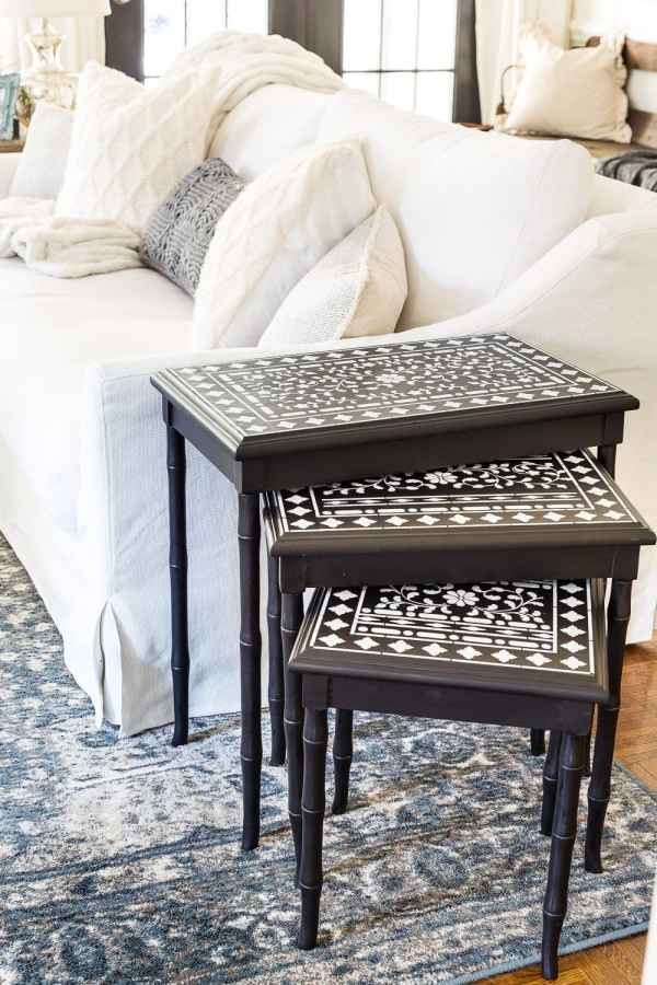 Tried and true ways to decorate and refresh your home completely for free (and maybe even make a little money in the process). #decorating #homedecor #budgetdecor Painted nesting end tables in a living room