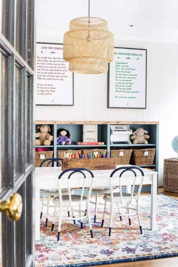 A playroom makeover with bamboo light fixture, adjustable play table, and miniature French bistro chairs. #playroom #kidsdecor