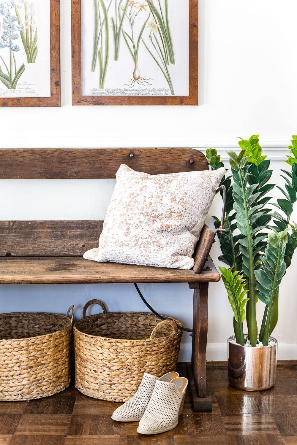 How to Disguise the Ugly Stuff in Your Home | Keep baskets under a bench for a makeshift mudroom with shoe storage.
