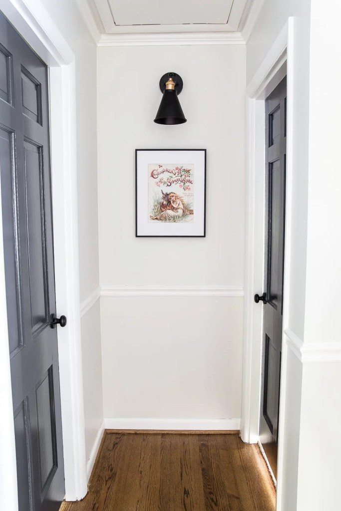Simple Thermostat Cover and Hallway Progress | A dark, beige hallway gets a light and bright makeover, plus a solution for creating an inexpensive thermostat cover and sconce lighting without the electrical work. #thermostatcover #hallway #hallwaymakeover #beforeandafter #sconce #sconcelight #walldecor #wallart #budgetdecor #freeart #decortrick #eyesorecover Thermostat Cover Art